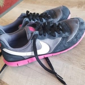 Newly washed pink and black Nike shoes